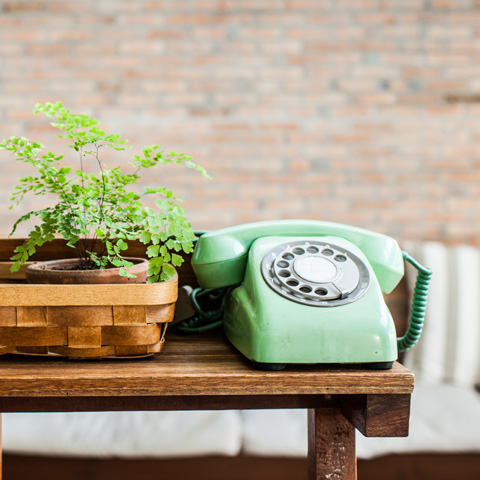 Green phone on a table